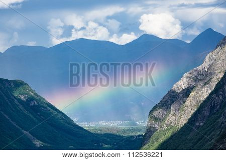 Landscape With Mountains And Rainbow In Norway