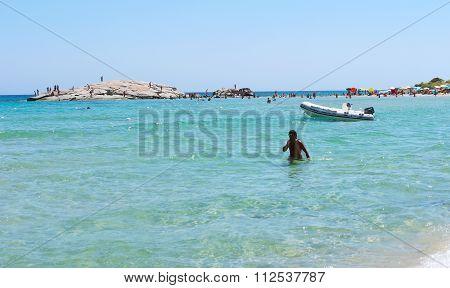 Costa Rei, Italy - August 25: Unidentified People In Beach Called Scoglio Di Peppino. Sunny Day In S