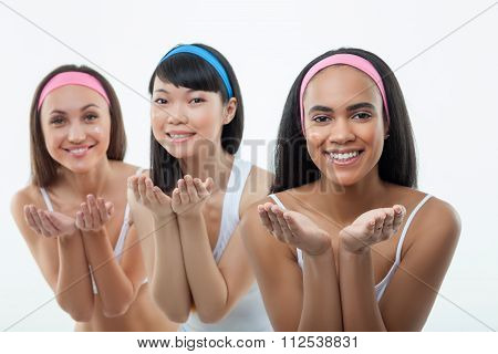 Cheerful young women are presenting their beauty