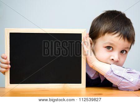 Cute Boy Is Holding Blackboard