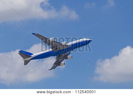 Airplane Againt Blue Sky
