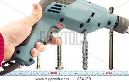Electric Drill In Hand Against The Background Of Various Bolts