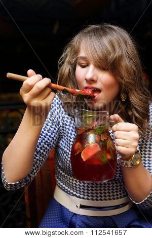 Teen Tasting Juice