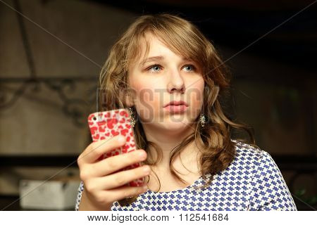 Teen Posing With A Smartphone