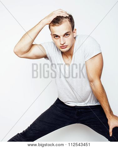 young handsome man on white background gesturing, pointing, posing emotional, cute guy