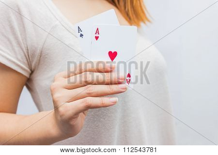 Young Woman Holding In Hand Poker Card With Combination Of Full House. In Focus Hand And Poker Card.