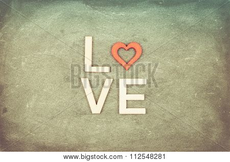 Vintage Chalkboard With Word Love Created Of Wood Letters, Retro Filter Applied