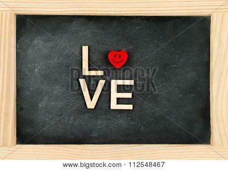 Wooden Frame Vintage Chalkboard With Word Love Created Of Wood Letters