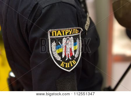 Chevron in the form of Ukrainian patrol officer with the inscription