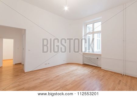 Fresh Renovated Room With Wooden Oak Floor, White Walls And Window