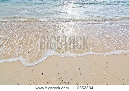 Foamy Wave On Sandy Beach