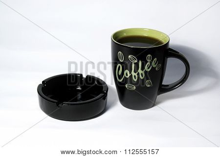 Cup Of Coffee And Black Ashtray