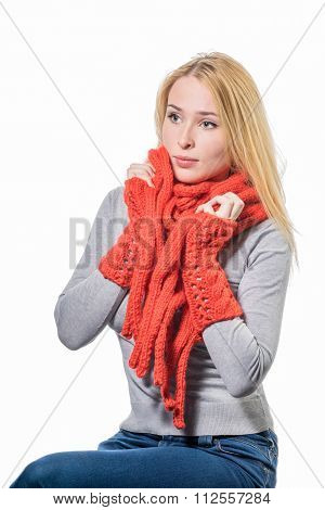 Cheerful Blonde Woman Wrapped Up Warmly In A Red Wool Winter Scarf Isolated On White