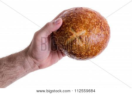 Male Hand Giving A Sourdough Bread Roll