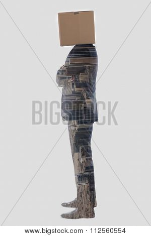 double exposure of anonymous business man with a cardboard box on his head concealing his identity