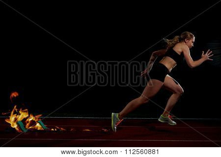 double exposure design of woman  sprinter leaving starting blocks on the athletic  track. Side view. exploding start