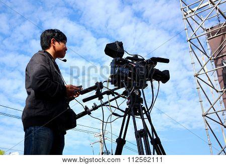Professional Camera Man Films Stage Performance