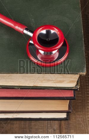 Red Stethoscope On Books Pile