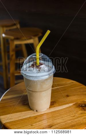 Capuchino Coffee In Take A Way Plastic Cup On Wooden Chair