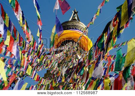 Colored Flags Hanging From The Top Of The Stupa Bodnath, Kathmandu