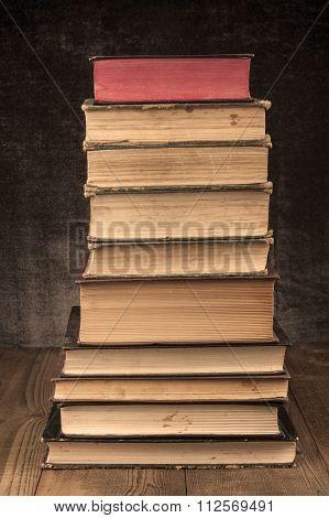Old Books Pile On Wood