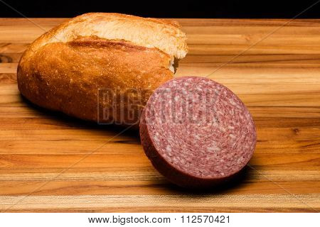 Torn Italian Bread And A Chunk Of Salami