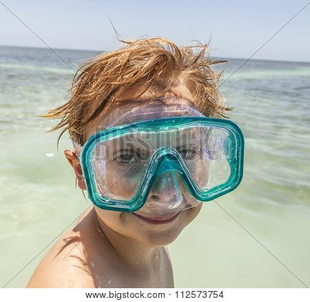 Boy With Diving Mask Enjoys The Ocean