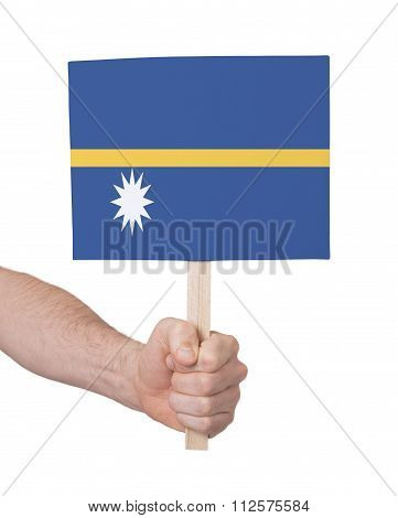 Hand Holding Small Card - Flag Of Nauru