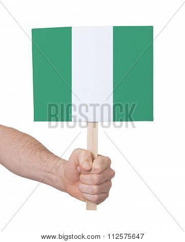 Hand Holding Small Card - Flag Of Nigeria