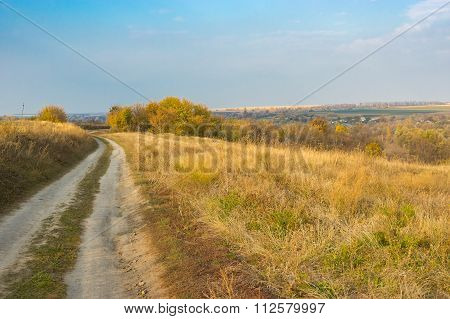 Landscape with earth road leading to remote village Grusheve in Sumskaya oblast Ukraine