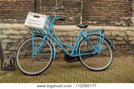 Bicycle Parked Against An Ancient Wall