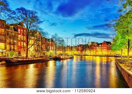 Famous Amstel River And Night View Of Beautiful Amsterdam City. Netherlands