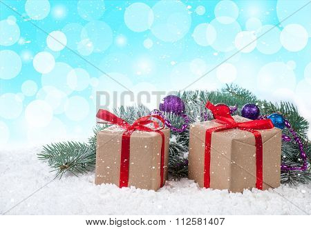 Gift Boxes Over Snow Bokeh Background