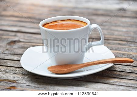 One Full Cup Of Espresso Coffee On Bamboo Table