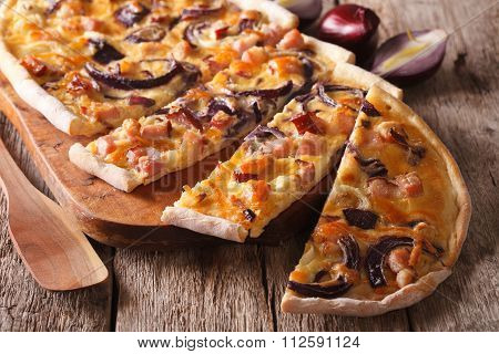 Sliced Pie Flammkuchen With Bacon And Red Onion Close-up. Horizontal