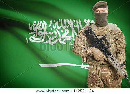 Soldier Holding Machine Gun With Flag On Background Series - Saudi Arabia