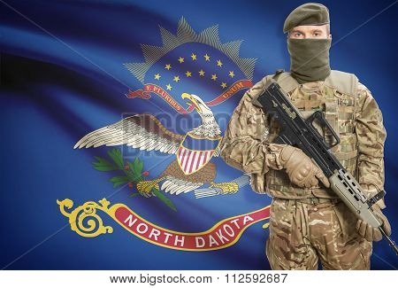 Soldier Holding Machine Gun With Usa State Flag On Background Series - North Dakota