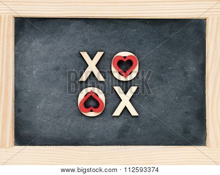 Wooden Frame Vintage Chalkboard With Text Xoxo (kisses & Hugs) Created Of Wood Letters
