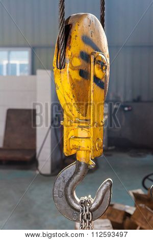 Old yellow iron hook