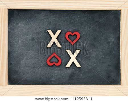Vintage Chalkboard With Text Xoxo (kisses & Hugs) Created Of Wood Letters
