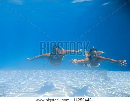 Split Underwater portrait of a woman snorkeling in tropical sea