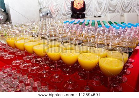 Glasses With Beverages On The Banquet Table
