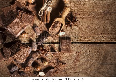 Chocolate pieces on wooden background