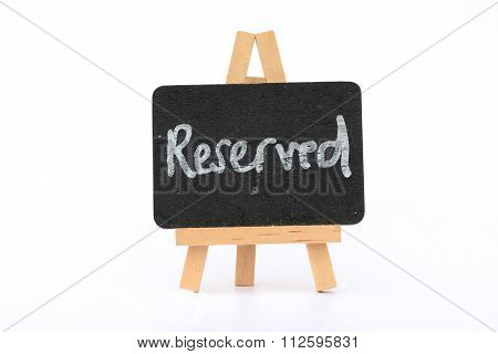 Reserved sign on easel