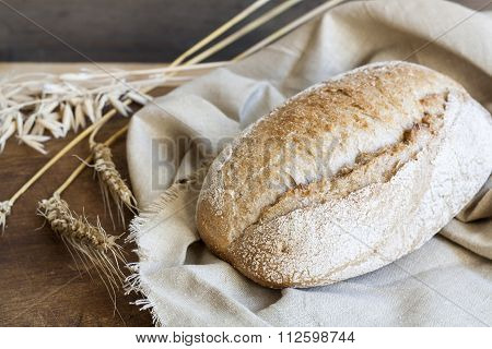 Freshly baked homemade bread on a wooden table.