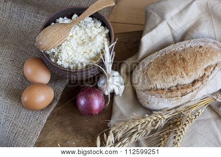 Rustic natural dairy products cottage cheese and bread