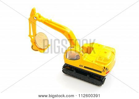 Euro Coin And Yellow Backhoe