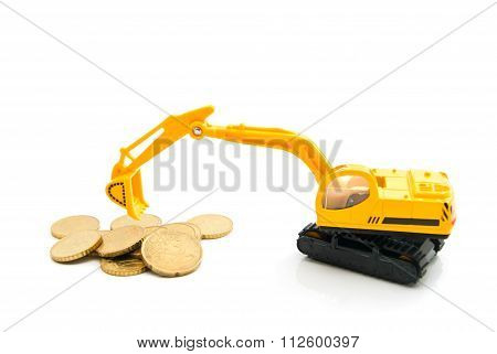 Yellow Backhoe And Coins