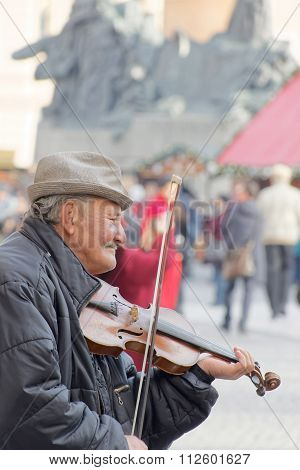 Old Man Playing The Violin