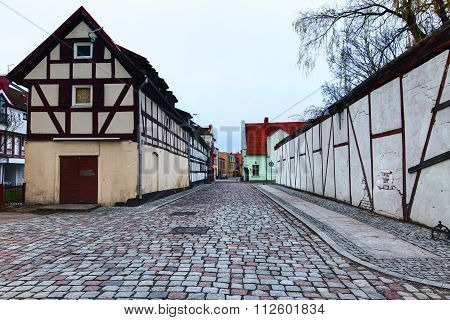 Narrow street with half-timbered residential houses. Market street